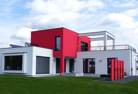 bungalows: new beautiful european bungalow - red and white - luxhaus Stock Photo