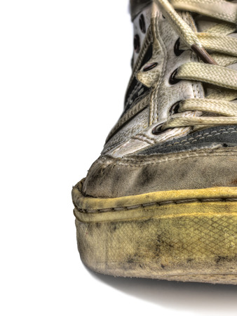 retro grunge: ugly old shoes isolated on white backgroud