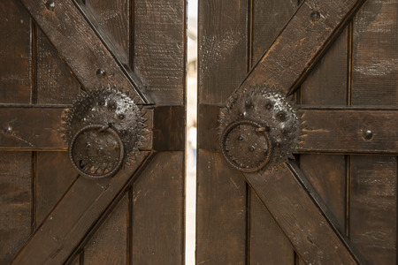 plating: Old oak wooden portal with metal plating Stock Photo