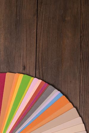 Colorful color paint catalogue on wooden desk photo