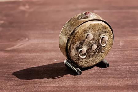 old desk: Old vintage alarm clock on wooden desk Stock Photo