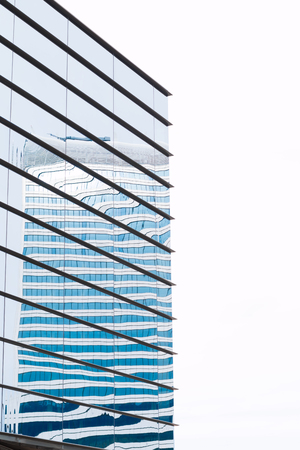 blue tone: Modern building mirror facade in blue tone