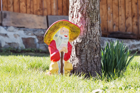 lawn gnome: Garden gnomes in an autumn garden in the grass Stock Photo