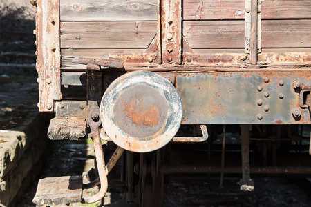 Old abandoned rusty wagon buffer close-up and details photo