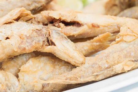 whitebait: Small dish of fried whitebait with slices of lemon