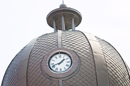 Clock On The Tower and metal dome photo