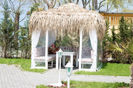 pergola: Image of a garden pergola on a sunny day with thatching