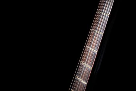 fingerboard: Acoustic Guitar Fingerboard Strings On Black Background