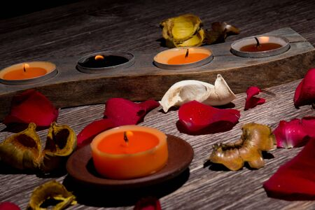 potpourri: Fresh Rose Petals, Potpourri And Candles on Wooden Background