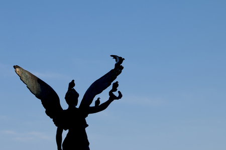 ancient philosophy: Statue of victory at  island in Greece with pigeons Stock Photo