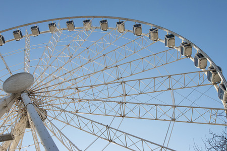 ferriswheel: Budapest Eye Ferris Wheel. Attraction in the Hungarian capital Against Blue Sky.