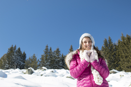 Portrait of a Girl with a gray hat in the mountains in winter