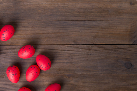 Red easter eggs on wooden background with copy space Reklamní fotografie