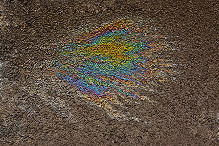 oil spill on the road detail Stock Photo