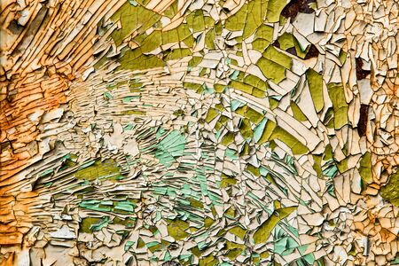 Old cracked colored paint green and orange Stock Photo