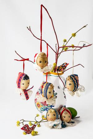 folk easter eggs in vase like folk dolls Stock Photo