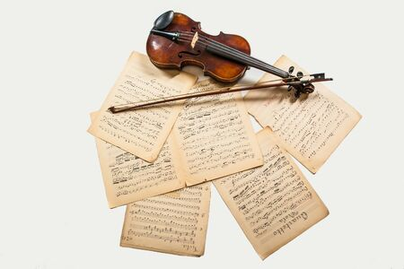 violin bow and notes on white background