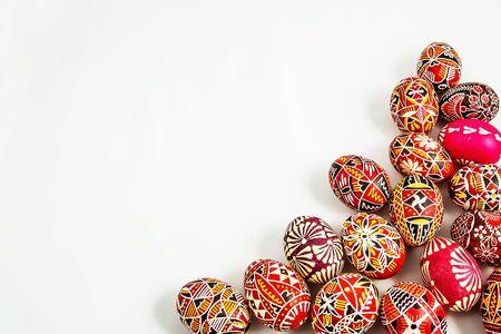 Folk Easter eggs on white background in the right corner