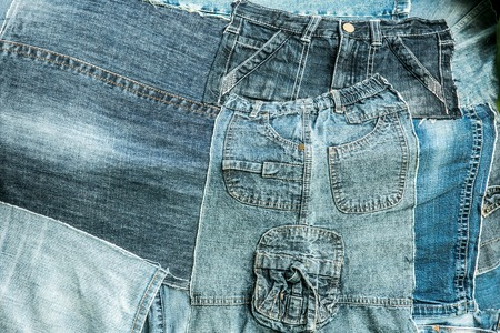 remnants of old jeans trousers folded like a collage