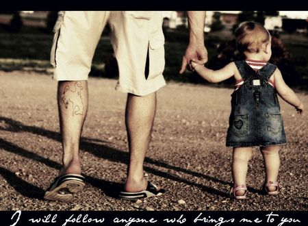 father & daughter taking a walk just before noon Stock Photo