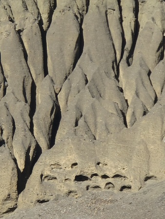 limestone caves: Ancient caves in the limestone cliffs of the Muktinath-valley Stock Photo