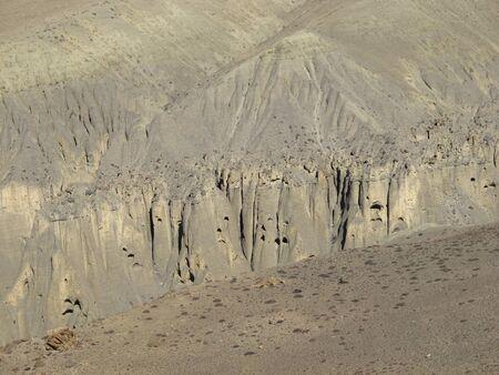 limestone caves: Limestone cliffs, caves. Mustang region, Nepal