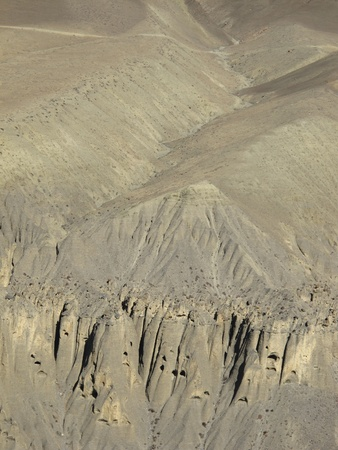 limestone caves: Limestone cliffs and caves in the Mustang region, Nepal Stock Photo