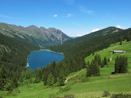 gstaad: Beautiful blue mountain lake in the Bernese Oberland