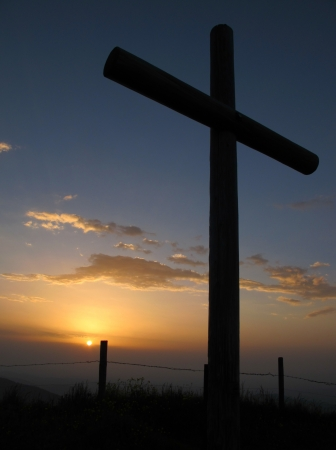 Catholic cross on the summit of a mountain photo