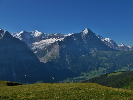 Eiger And Paragliders, Grindelwald Stock Photo