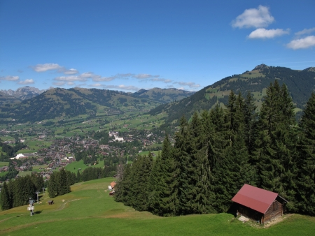 gstaad: View Of Gstaad, Ski Lift In The Summer, Forest Stock Photo