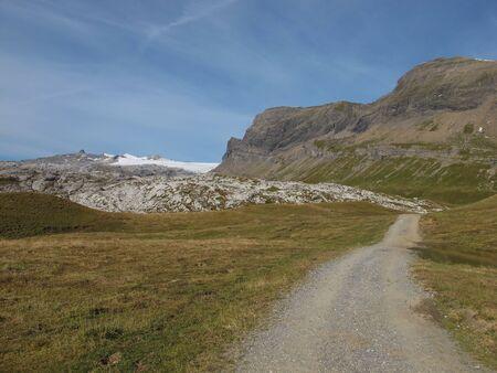 Dirt Road, Glacier De Diablerets And Mountains