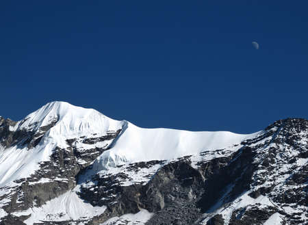 in high mountain: Moon Over A High Mountain In The Annapurna Conservation Area