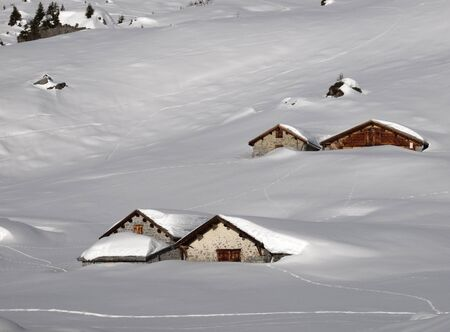 Huts covered by lots of snow Stock Photo