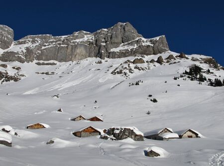 winter scenery: Winter scenery, snow covered huts and mountains