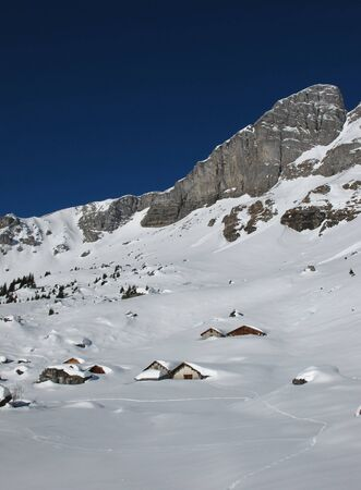 winter scenery: Winter scenery in the mountains, huts