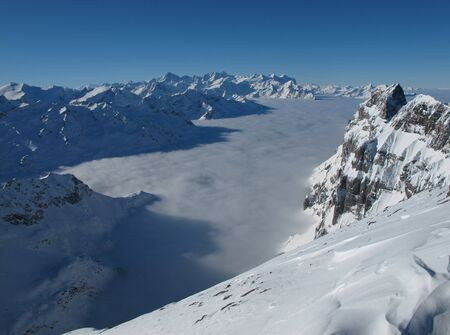 Above the sea of fog, mountains in the winter, Titlis photo