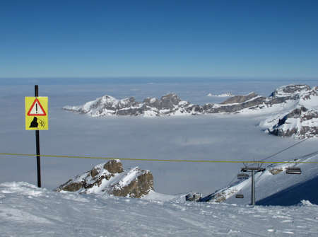 Cliffs, danger sign, mountains and sea of fog, Titlis Stock Photo - 17604313