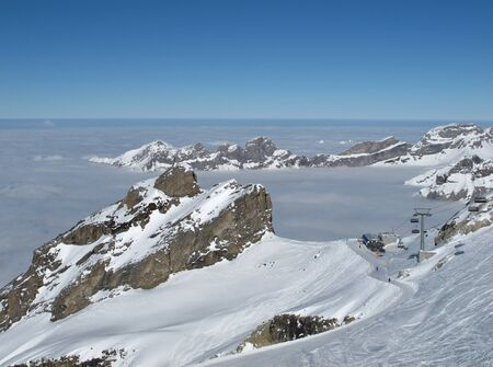 chair lift: Winter day on the Titlis, Chair lift and sea of fog