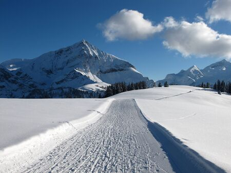 Spitzhorn, slope and clouds, winter landscape Stock Photo