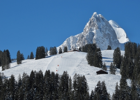 gstaad: Ski slope and beautiful mountain Stock Photo