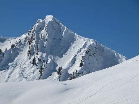 saanenland: Mountain peak in the winter
