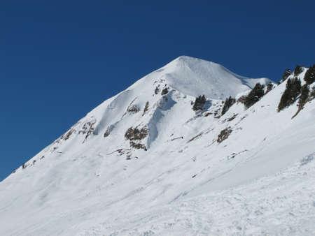canton berne: Mountain peak and ski tracks Stock Photo