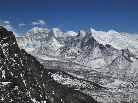 Frozen lake Imja Tsho, glacier and high mountains photo