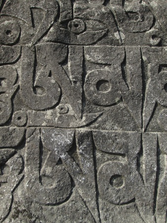 Religious inscription on a mani stone, Nepal photo