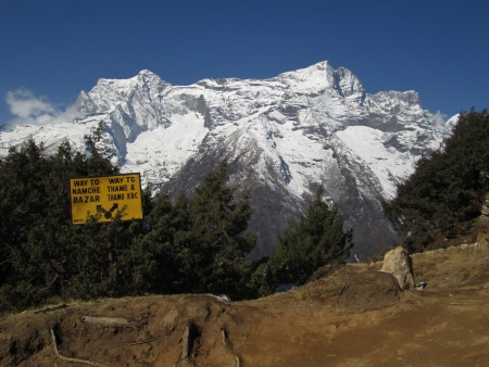 snow capped: Signpost in Namche Bazar, snow capped mountain Stock Photo