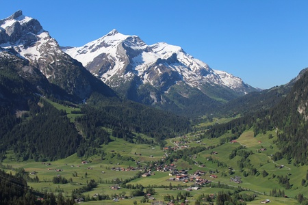 snow capped: Village Gsteig bei Gstaad and snow capped mountain named Oldenhorn