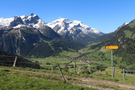 saanenland: Beautiful mountain landscape and directional sign in the Swiss Alps
