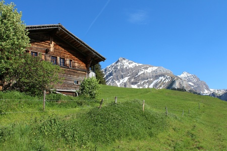 Old house and mountain in the Swiss Alps