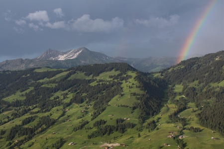 gsteig bei gstaad: Green hill and rainbow, scenery in the Bernese Oberland